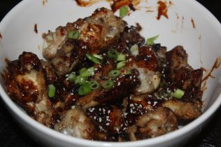 Top the wings with scallions and sesame seeds!