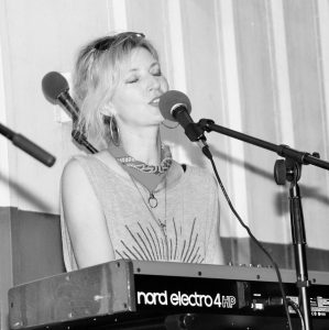 Black and White of Emily Shirley performing music