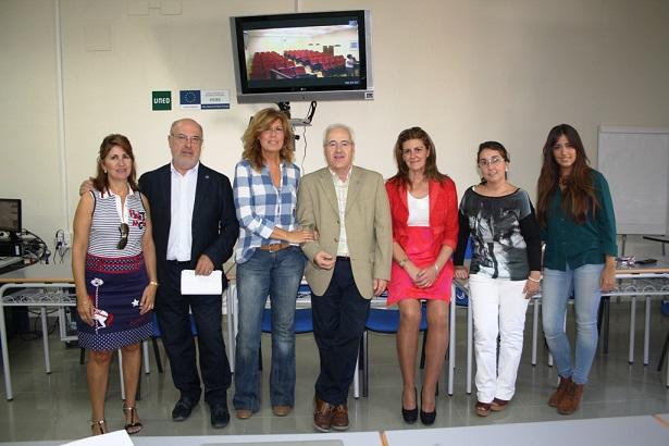 Joaquín Arias, Rosa María Fernández de Moya y Andrés Medina, en el centro.