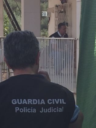 Fotografía de los dos negociadores momentos antes de la detención.