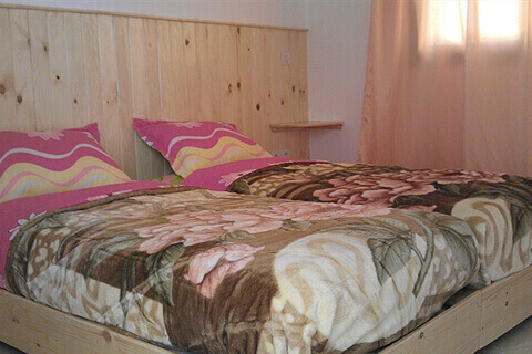 Camping Aourir – A bedroom at the Apartments at the Campsite which you can rent