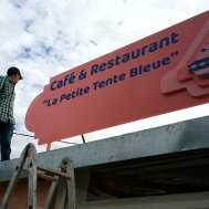 Sticking letters on the restaurant billboard