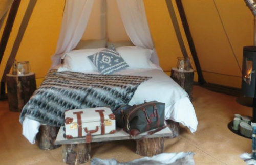 Inside the Super Deluxe Tipi - proper bed and mattress