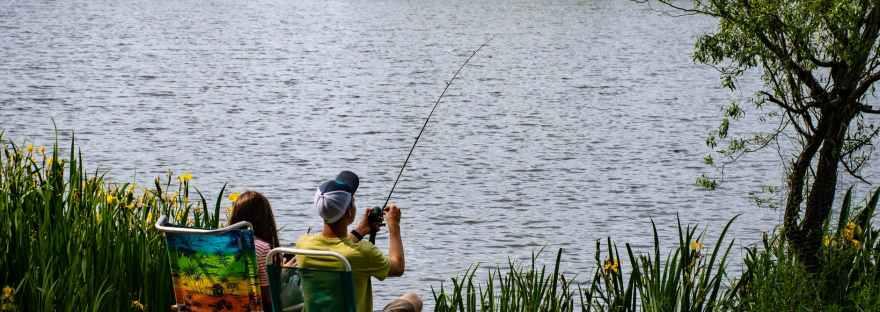 fishing man wearing yellow shirt
