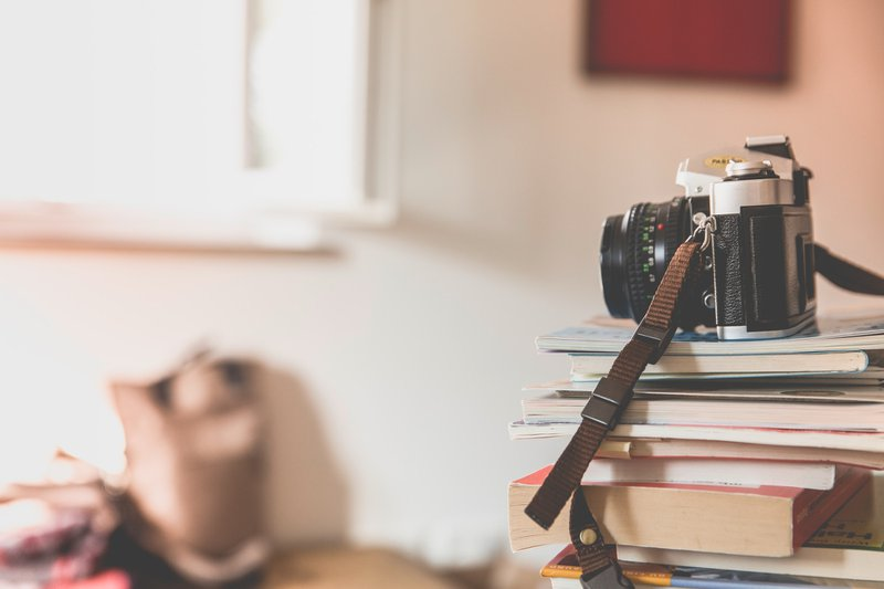 Camera on stack of books