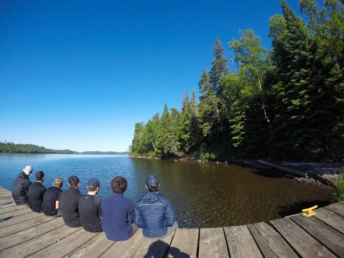 Campers sitting on a dock, isle royale