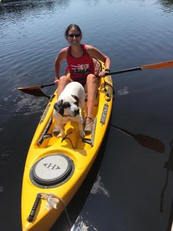 Alyssa PEcorino and her dog, Spencer, on a kayak