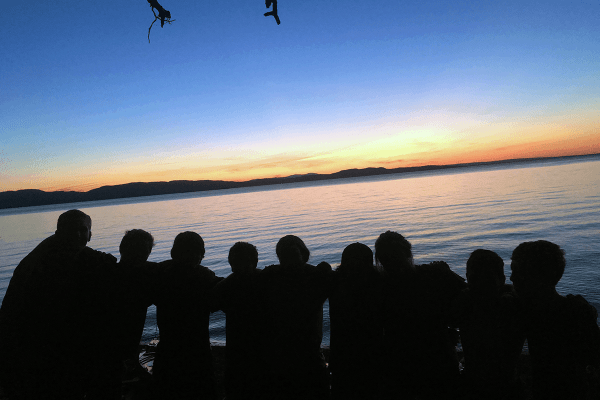 Image of kids enjoying a sunset together during Champlain Discovery, a Lake Champlain Maritime Museum summer expedition.