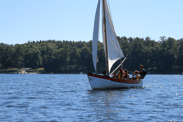 Image of kids sailing in the whaleboat on Lake Champlain.