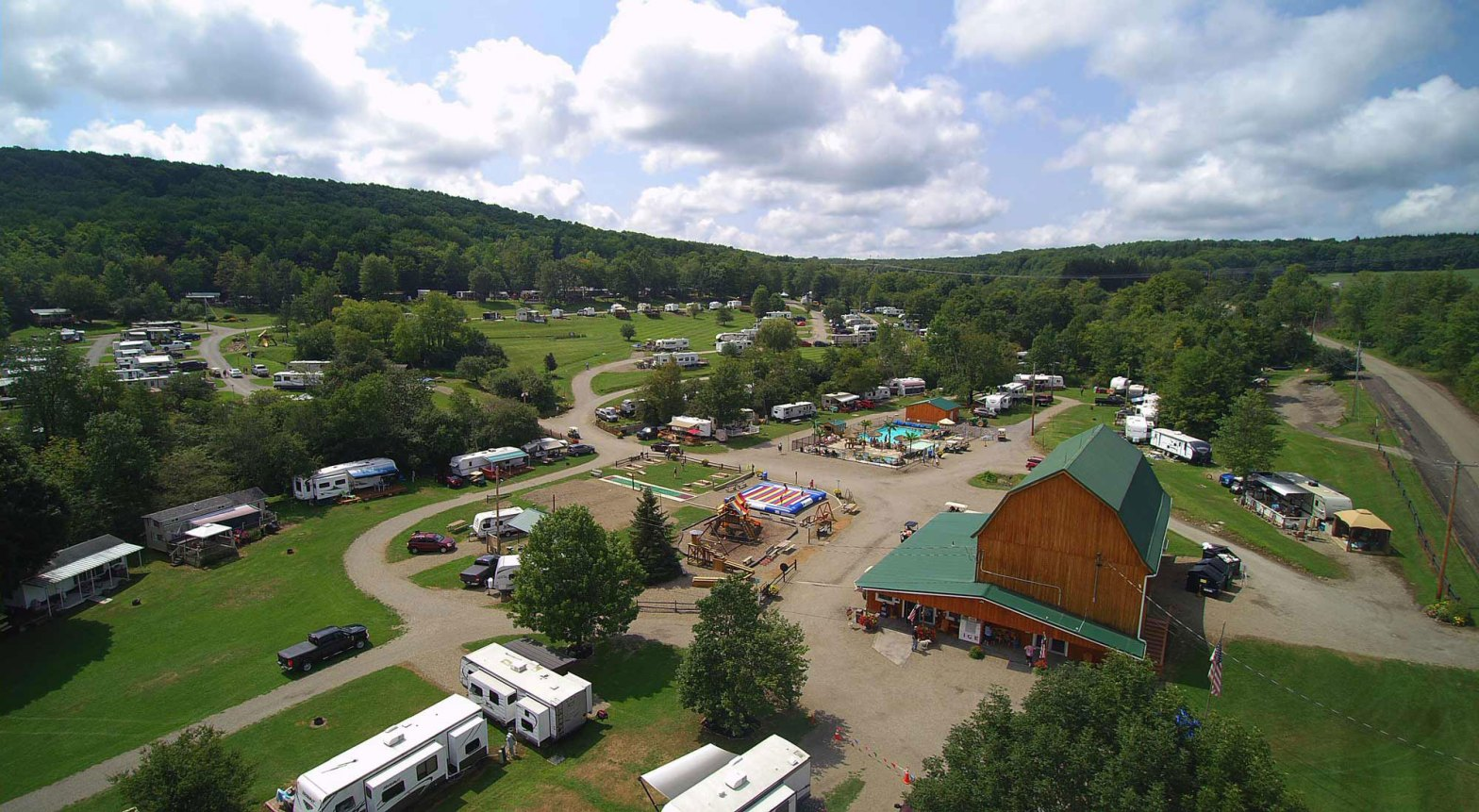 Aerial view of Triple R Campground with pool and barn