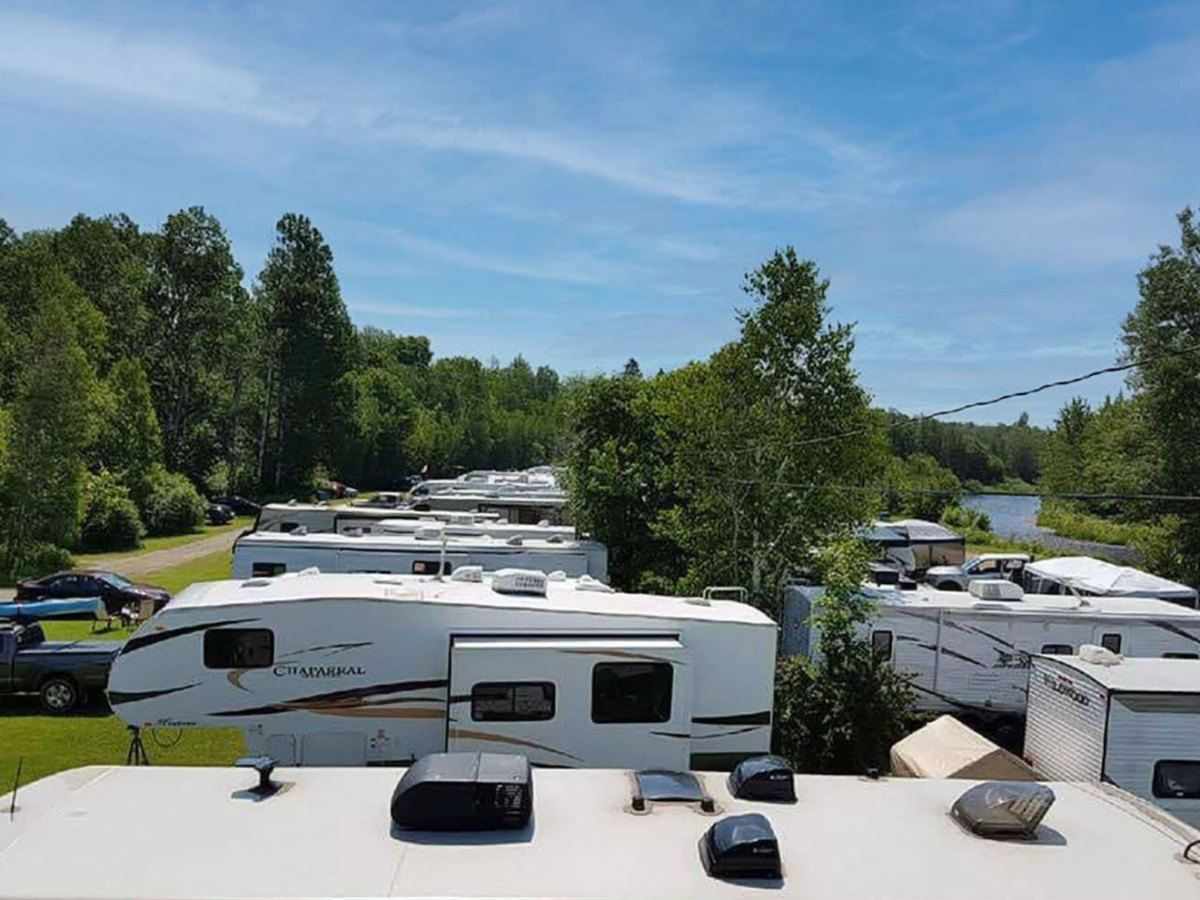 campground rows of trailers parked in green field