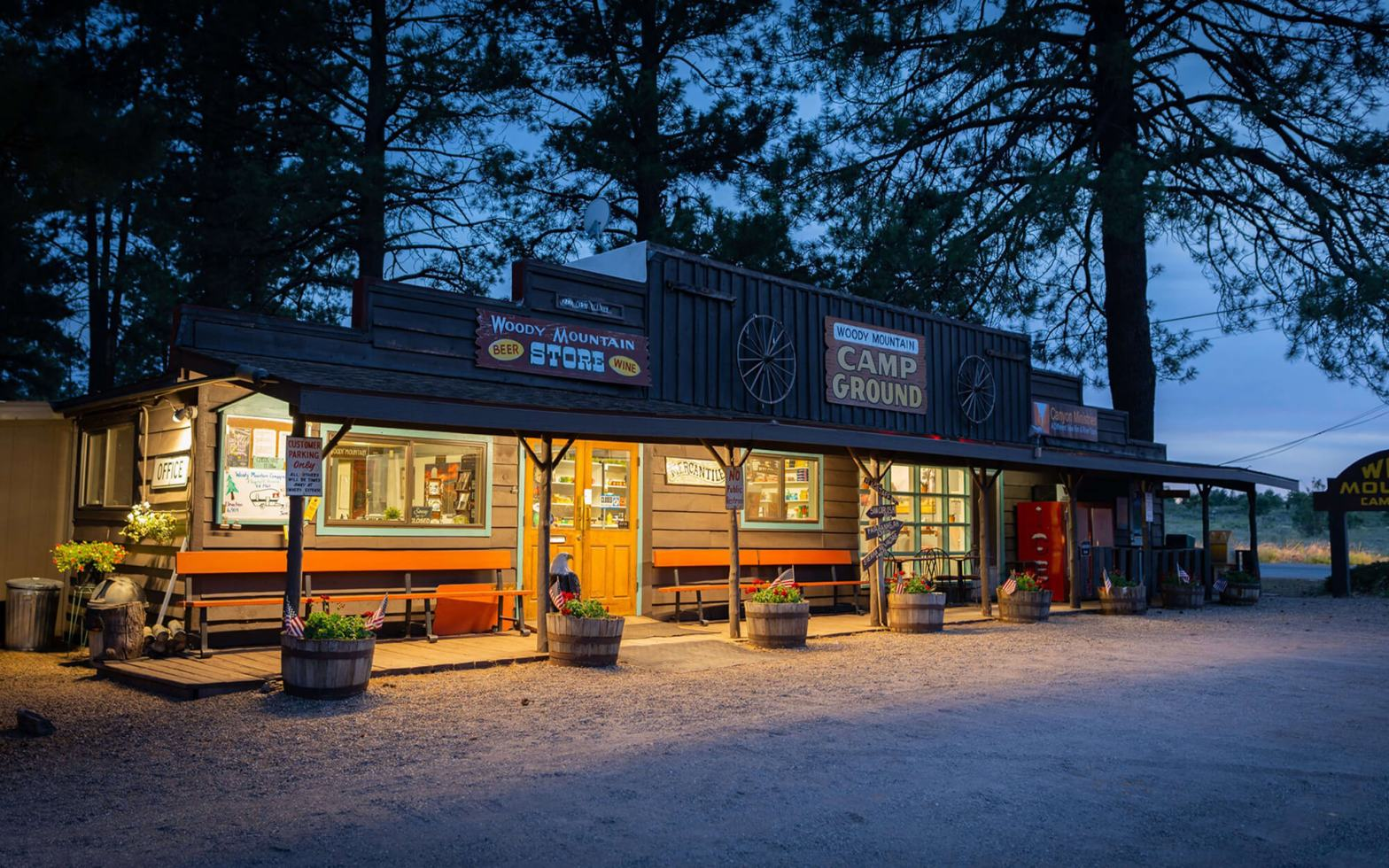outside of camp store in evening with window lights