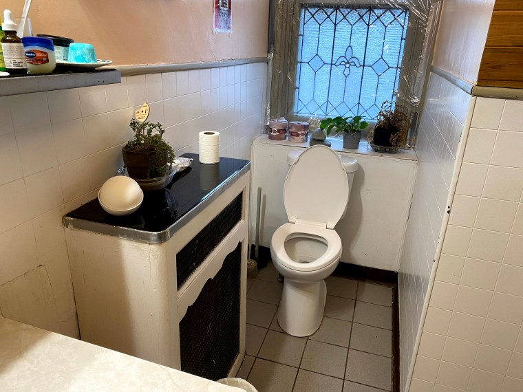 A bathroom with a toilet and sink