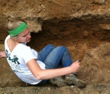 Bethany excavating the old road near MSU Museum