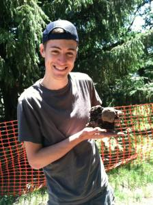 Ryan- holding a door knob he found during a CAP excavation