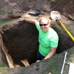 Me(Kate) showing the depth of the pit.