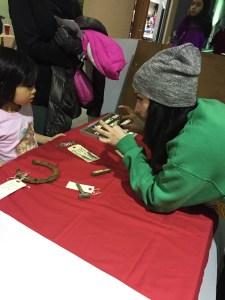 Amy explains an artifact at Bennett Woods Elementary School Science Fair