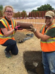 Becca Albert and Jack Biggs remove a large piece of water pipe - Image Source Lisa Bright