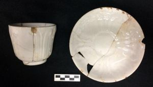 Berlin Swirl handless cup and matching saucer. Recovered from West Circle Privy