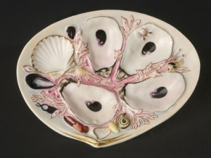 Oyster plates for serving oysters. Image Source