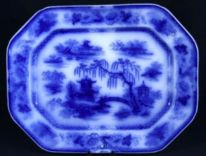 Flow blue plate featuring Oriental motifs. Image from passionforthepastantiques.com