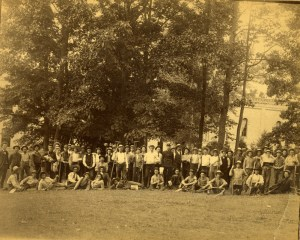 Agricultural students posing with farm implements on campus,1886