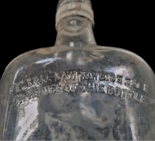 """Federal Law Forbids Sale or Reuse of This Bottle"""