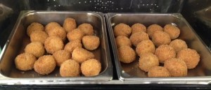 Cod fish balls and potato croquettes served at the luncheon.
