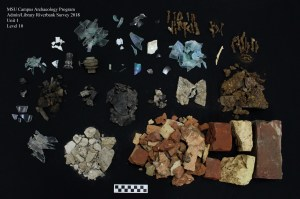 Image shows artifacts from level 10 uncovered in the 1x1 m unit on the north bank of the river.