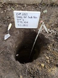 Shovel Test Dug during Yakeley Hall Patio Replacement. Shows soil and measuring tape