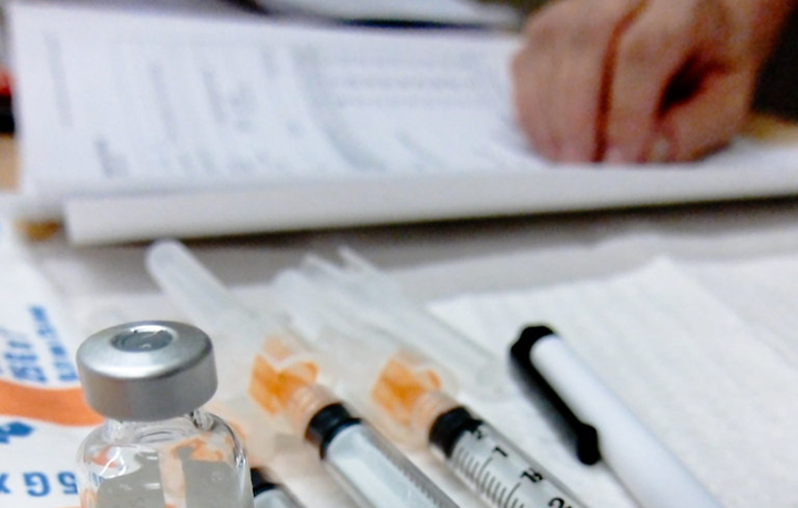 Vaccine vial and syringes