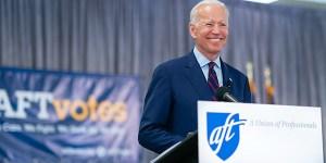 Biden in front of AFT banner