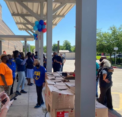 Brighter Bites volunteers with boxes of fruits and vegetables