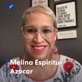 Melina smiling, short blond hair, glasses and dark eyes. Links to video.