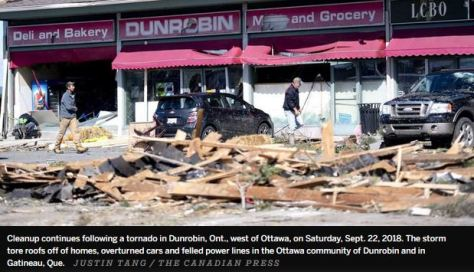 Cleanup continues following a tornado in Dunrobin, Ont., west of Ottawa on Sunday, Sept. 22, 2018. Justin Tang - The Canadian Press