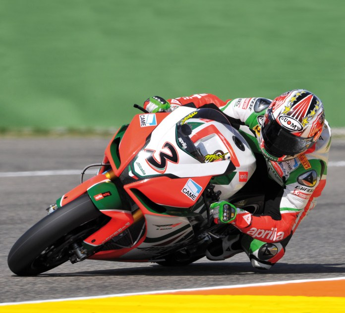 Max Biaggi and Aprilia remain in the spotlight for not only winning, but controversy, with discovery of an illegal fuel injection system.