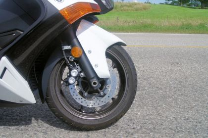 The T Max has beefy front brakes, but no ABS.
