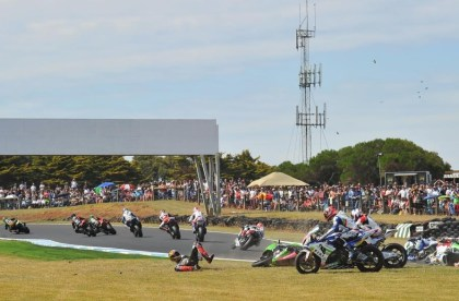Melandri and Checa weren't the only notables to crash; Here, Loris Baz gets dumped, thanks to a little help from Chaz Davies. Photo: WSBK