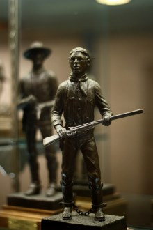 A statue of Billy the Kid in the Roswell museum, with Pat Garret following. Photo: Zac Kurylyk