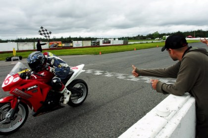 Tomas Casas gets the thumbs-up from his dad. He took both wins in the CBR250 double-header.