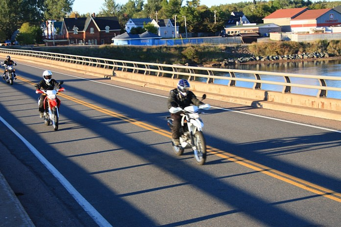 A squad of D2D riders blasts through Pugwash, NS around 6 pm. Photo: Zac Kurylyk