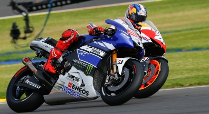 Jorge Lorenzo worked hard for his win, and worked the opposition over hard as well. Here, he muscles Dani Pedrosa around. Photo: MotoGP