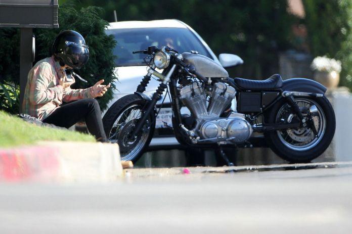 Harry Styles vs. the Sportster. Photo: Mirror