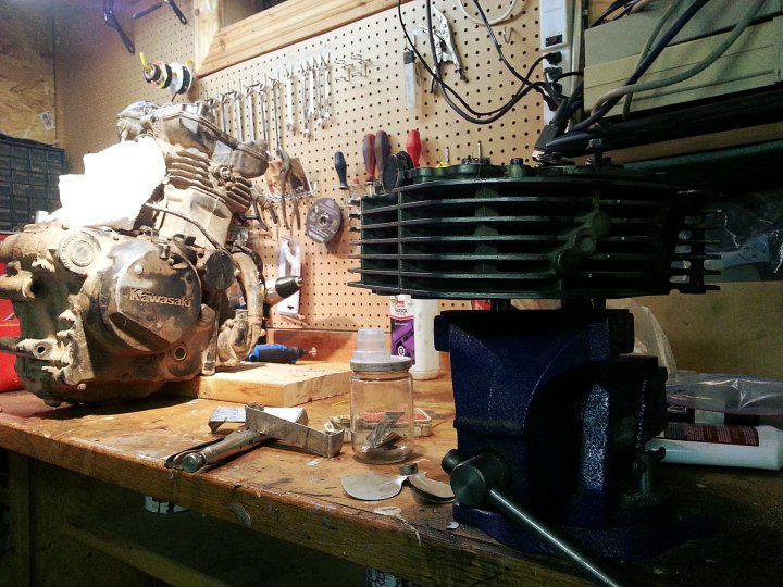 In Editor 'Arris's workshop. Note the out-of-commission motor from the project KLR in the background.