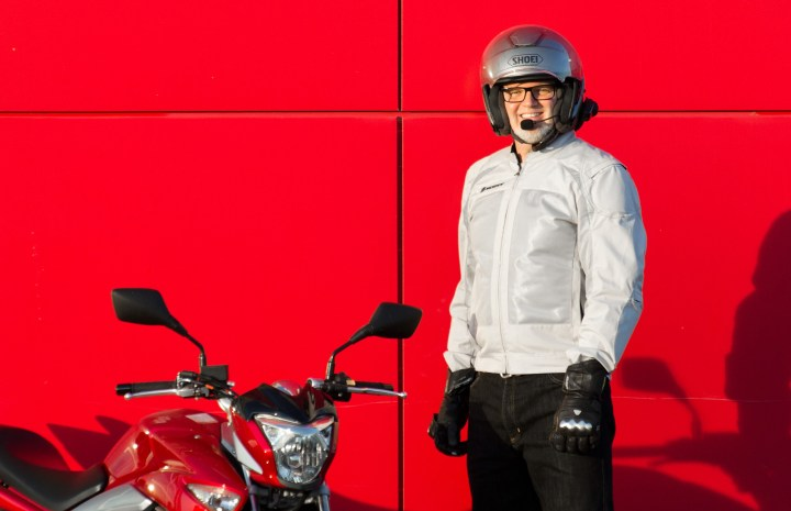 Here I am, still stuck in the same position where I looked reasonably good in the jacket, doing my best to suck in my gut and smile. Although the whole 2013 ensemble blends well with our new Suzuki GW250, I just don't have the physique for this jacket.