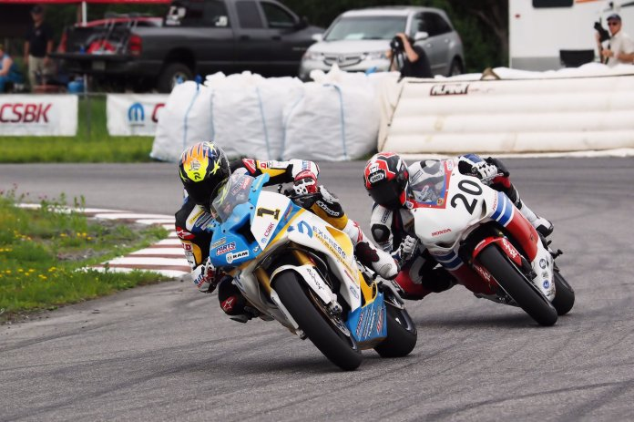 What keeps Szoke ahead of the competition? Mental toughness and smarts, say observers and fellow racers. Here, he breaks away from Jodi Christie in 2014. Photo: Rob O'Brien