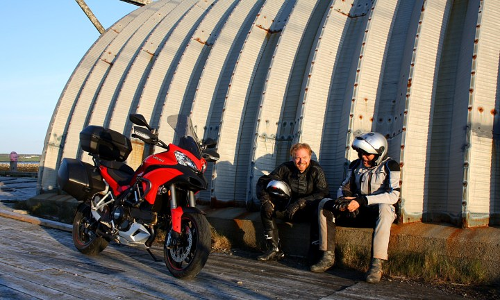 """Ha! Ha! Won't Kurylyk be upset when this bike won't start for him!"" - Uhlarik and 'Arris congratulate themselves on their always-reliable mounts. Photo: Zac Kurylyk"