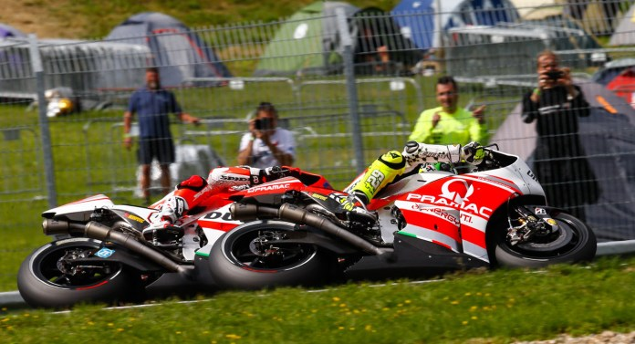 Dovizioso and Iannone finished close together in fifth and sixth, but Cal Crutchlow managed to screw up his shoulder, and his bike's electronics, going off-track, and had to retire.