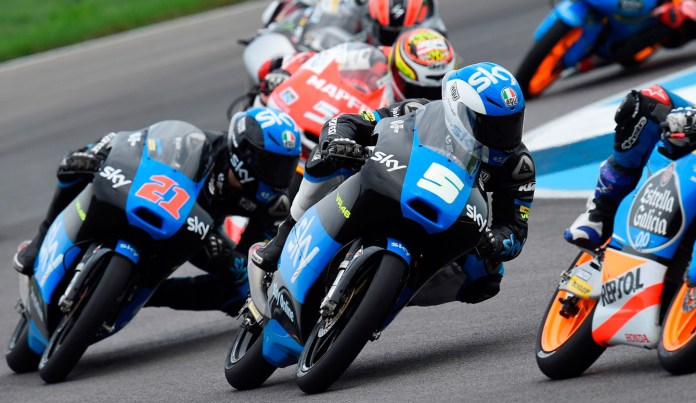 Roman Fenati (5) lost his lead and finished second in Moto3 by fractions of a second.