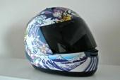 A full-face helmet with a flashy paint job.